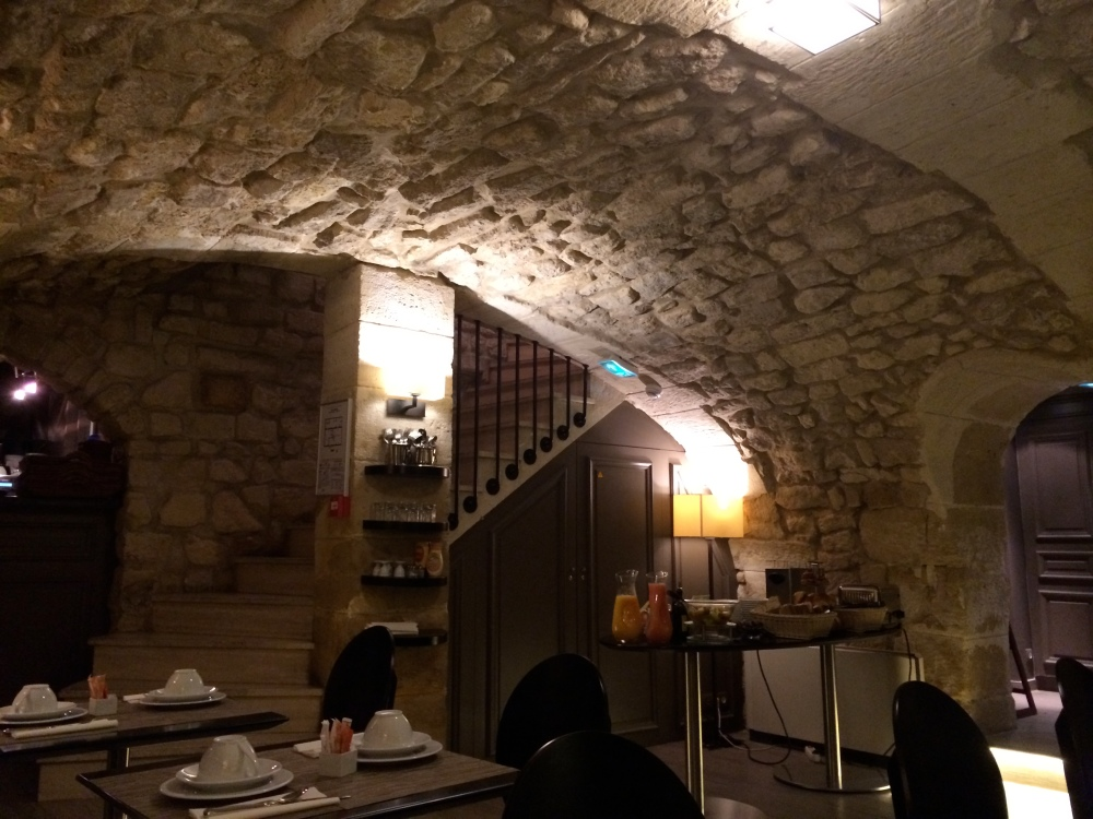 Cozy underground dining area at Hotel Verneuil